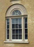 Close view of detail of exterior of Llanerchaeron by John Nash, 1794-96,showing recessed venetian window with carved stone sunray design, carved mullions and slender glazing bars