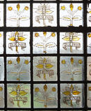 Close shot of stained glass in window with William Morris motto 'Si je puis'('If I can') at Red House,
