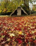 The Boat House in the grounds of Scotney Castle, surrounded by a carpet of colourful autumn leaves