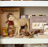 Close up of the toy shelf in display case in The P.M.Ward Collection at Llanerchaeron.