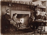 Sepia photograph of Alfred, Joseph and Graham Baron Ash seated around the fireplace in the Hall, in the Lookout Room at Packwood House