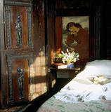 A corner of the Oak Room at Wightwick Manor with period carvings and paintings based on early Rossetti works