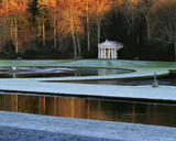 The Temple of Piety seen across the Moon and Half Crescent ponds at Studley Royal Garden, North Yorkshire