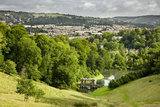 A view of the valley parkland with the Palladian Bridge, and beyond to the skyline of Bath, at Prior Park Landscape Garden