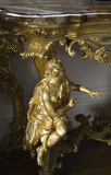 Gilded figure on the leg of a marble topped table on the half-landing of the Staircase at Arlington Court, Devon
