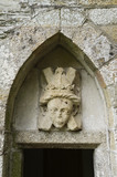 Carved stone head above the visitors' entrance door at Buckland Abbey, Yelverton, Devon