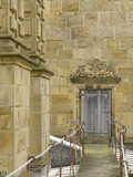 Door with Bess of Hardwick's arms over to the Banqueting Room in the south turret, on the roof at Hardwick Hall, Derbyshire