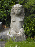 Small statue of a Sphynx beside the steps to the Pool Garden at Hinton Ampner, Hampshire