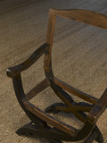 "Close view of the ""x"" frame of a chair in the Green Velvet Room at Hardwick Hall, Derbyshire"