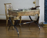 A small French table with bronze edged top and black arched legs in the Boudoir at Berrington Hall, Herefordshire