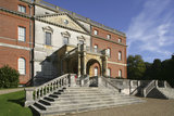 Entrance or west front with pedimented section, or porte-cochere, added in 1876, and staircase at Clandon Park, Guildford, Surrey, built around 1731 by Italian architect Giacomo Leoni