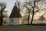 The Summerhouse in the Orchard at sunrise in winter at Sissinghurst Castle Garden, near Cranbrook, Kent