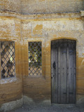 Wooden door and glittering glass windows at Montacute House, Somerset