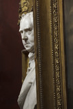 Close view of a sculpture bust and picture frames in the North Gallery at Petworth House, West Sussex