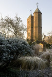The Elizabethan Tower in the distnace with the frosty White Garden foliage in the foreground at Sissinghurst Castle Garden, near Cranbrook, Kent