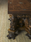 Close view of the leg in the form of a chimera or sea dog resting on the foot in the shape of a tortoise, of the sea-dog table in the Withdrawing Chamber at Hardwick Hall, Derbyshire
