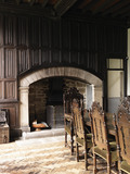 Fireplace and linenfold panelling in the Dining Room at Godolphin, near Helston, Cornwall