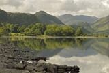 A fine morning view from the east shore of Derwentwater with Castle Crag (a conical wooded hill) visible in the upper right background