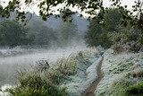 A frosty winter scene along the towpath at the River Wey Navigations, Surrey