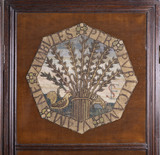 Octagonal canvas-work panel showing plants or herbs derived from sixteenth-century botanical plate books, at Hardwick Hall, Derbyshire