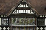 Close view of the black and white half-timbering and windows of the East Wing at Wightwick Manor, Wolverhampton, West Midlands
