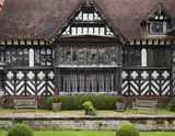 Close view of the black and white half-timbering and bay window of the East Wing at Wightwick Manor, Wolverhampton, West Midlands