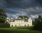 The west front of Saltram, the creamy grey building contrasting vividly with the black menacing sky