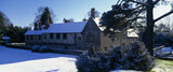 The northern aspect of Ightham Mote in the early morning, under a light blanket of snow