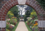 View through arch showing summer border and fountain at Nymans Garden