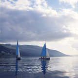 Sailing boats on lake Coniston with low cloud, Cumbria