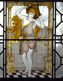 Painted glass by C E Kempe representing Autumn and illustrating the passage from William Morris'
