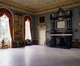 A room view of the Saloon at Clandon Park looking towards the impressive fireplace and a Mortlake tapestry woven c