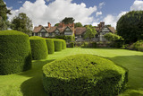Wightwick Manor, Wolverhampton, West Midlands, seen beyond the yew topiary of the Lower Lawn