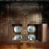 A built-in cupboard at Wightwick Manor made from a Flemish oak window casement, in the Morning Room