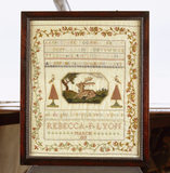 A sampler by Rebecca Lyon, 1819, on the Upstairs Landing of Stoneacre