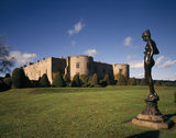 View of the East Elevation of Chirk Castle with topiary and a Nymph statue