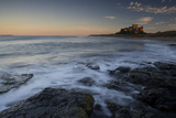 A long view at sunset of Bamburgh Castle on the far horizon (Not National Trust)