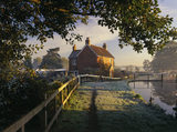 Lock-keepers' cottage on a frosty and misty morning at Papercourt Lock, River Wey Navigation