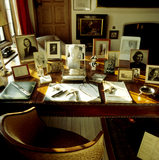 Desk in the study at Chartwell showing family photographs, two porcelain busts of Napoleon and Nelson in biscuit Sevres by Antoine-Denis Chaudet