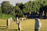 Avebury: Partial view of stone circle, with buildings behind