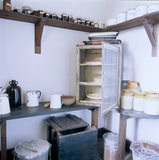 View towards the corner of the Larder at Sunnycroft, showing the meat safe and earthenware jars for storing beans and eggs