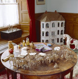 Table detail showing the swiss noah's ark animals (1856), russian dolls, halma game, playing cards at the Day Nursery at Lanhydrock