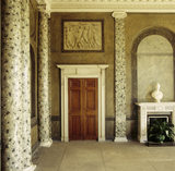 East wall of the Entrance Hall with a grisaille over the door by Robert Fagan at Attingham