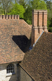 Distinctive seventeenth-century chimneys photographed from the top of the Gatehouse Tower at Ightham Mote, Sevenoaks, Kent, a fourteenth-century moated manor house