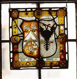 A fragment of stained glass,hanging in the triple-light windows, attributable to John Lyte and dating from the first half of C16th