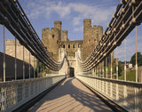 A view towards the Conwy Castle from the central span of the Conwy Suspension Bridge