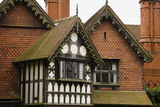 Close view of the black and white half-timbering and tile-hung gables on the Entrance Front at Wightwick Manor, Wolverhampton, West Midlands