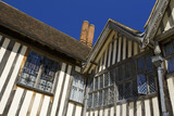 Detail of the windows and half-timbering on the corner of the North and East Range at Ightham Mote, Sevenoaks, Kent