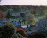 A high angle view of the grounds at Lanhydrock, looking down towards the formal garden and gatehouse