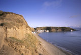 A fishing hamlet tucked into a sheltered east facing cove behind a headland on the Lleyn Peninsula